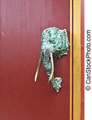 The elephant head is a door handle.
