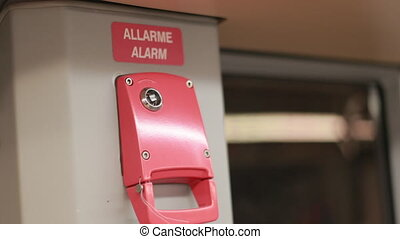 The Emergency Brake Is Red In A Subway Car That Is Traveling While Driving