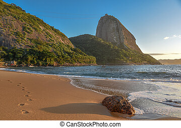 The empty beach Praia Vermelha and Sugarloaf mountain on the background