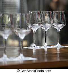 the empty glasses on the table for a banquet