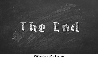"Hand drawing text ""THE END"" on blackboard."