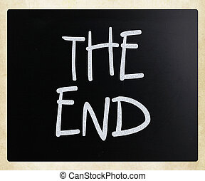 """The End"" handwritten with white chalk on a blackboard."