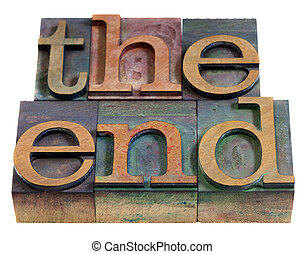 The end concept - words in vintage wooden letterpress printing blocks, stained by color inks, isolated on white