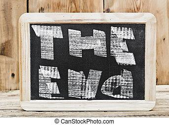 The end. Writings on blackboard.