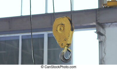 The engine hoist in workshop on the factory in full HD