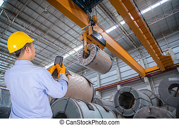 The engineer control the crane