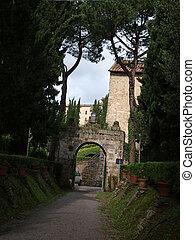 The entrance and the alley in the Tuscan estate