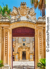 The entrance arch leading to the forecourt of the Vilhena Palace in Mdina, Malta, Europe.