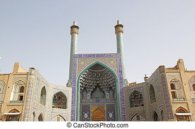 Isfahan - The entrance iwan with its towering facade of the...