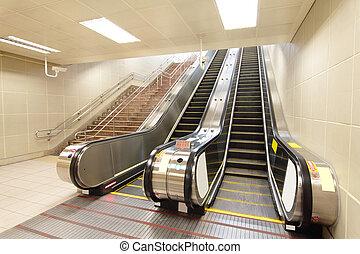The escalator moving at a metro railway station, shot in Taipei, Taiwan, asia