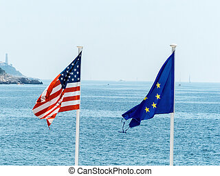 the eu and us flags - flags of the european union and the...