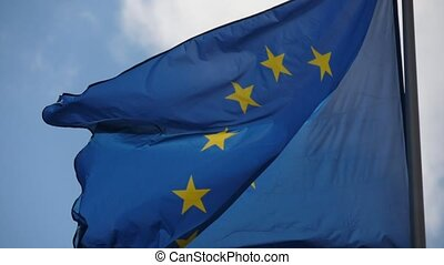 The EU banner, the symbol of unity, fluttering on a flagpole...