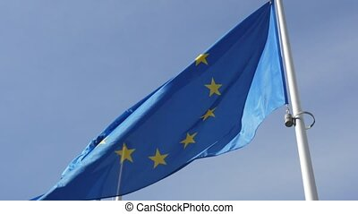 The EU flag, the sign of democracy and freedom, fluttering...