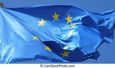 The EU flag, the symbol of democracy, flying on a flagpole...
