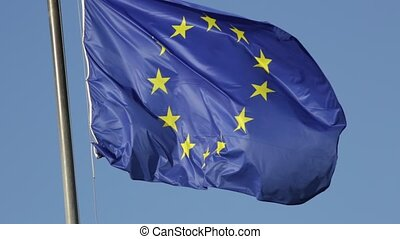 the Europe Flag - blue Europe flag waving in the wind on...