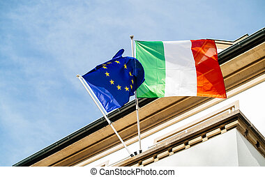 The European flag of Europe and Italian flag waving low angle view