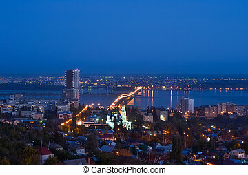 the evening city of Saratov with the bridge through the Volga River