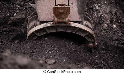 The excavator loads the coal. - The excavator loads the coal...