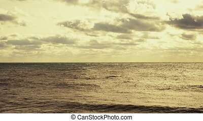 The excitement of the ocean with the sun and clouds