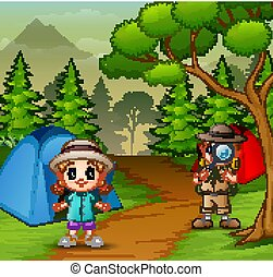 The explorer boy with a little girl at campsite