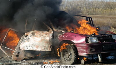 The explosion of the wheel of a car burning on the highway....