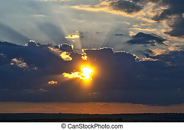 the expressive contrast of the clouds in the sky. sunset with bright clouds