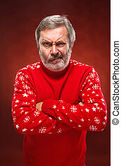 The expressive portrait on red background of a pouter man