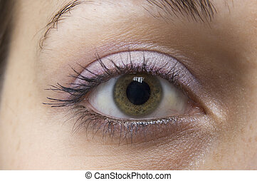 A close-up shot of an eye with make-up