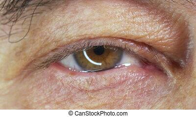 The eye of an elderly man, close up