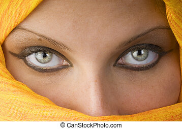 the eyes - attactive and strong eyes behind an orange scarf...