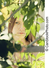 woman in a green summer foliage