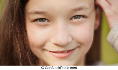 The face of a young girl of 11 years old close-up.