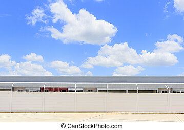 The factory building with the sky and cloud in midday scene