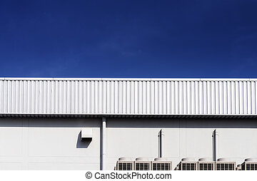 the factory wall and the blue sky day