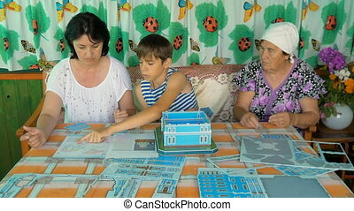 The family at the table playing a game
