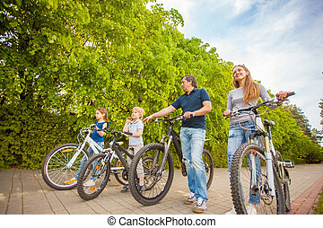 family in the park on bicycles