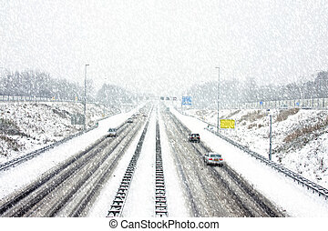 The famous A9 in a snowstorm in winter near Amsterdam the Nether