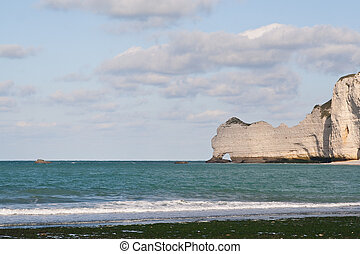 The famous cliffs at Etretat in Normandy, France. Tide sea