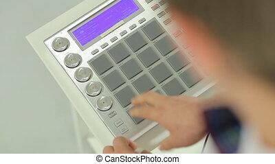 The famous DJ mix music on DJ mixer in studio