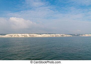 The famous Dover chalk cliffs seen from a ferry boat