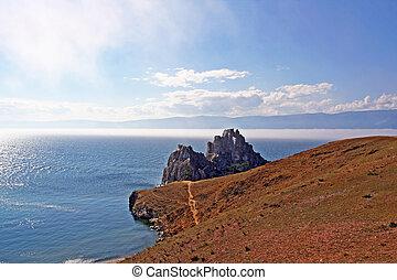 the famous Shaman Rock at Olkhon Island, Russian Siberia -...