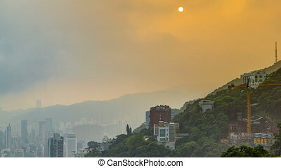 The famous view of Hong Kong from Victoria Peak timelapse. Taken at sunrise while the sun climbs over hill in Kowloon Bay.