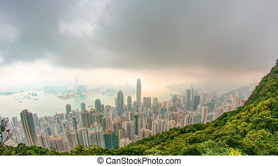The famous view of Hong Kong from Victoria Peak timelapse. Taken at sunrise with colorful clouds over Kowloon Bay.