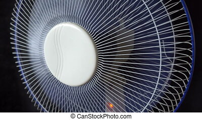 the fan is spinning on black background
