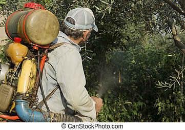 The farmer sprays garden plants