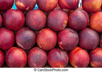The farmer's crop of peaches is on display. Background.