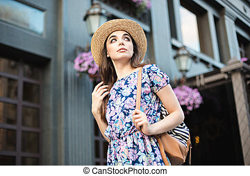 The fashion woman portrait of young pretty trendy girl posing at the city in Europe