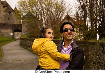 The father and his daughter on the road