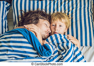 father is sleeping with his son