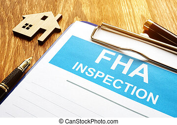 The Federal Housing Administration FHA inspection report and clipboard.